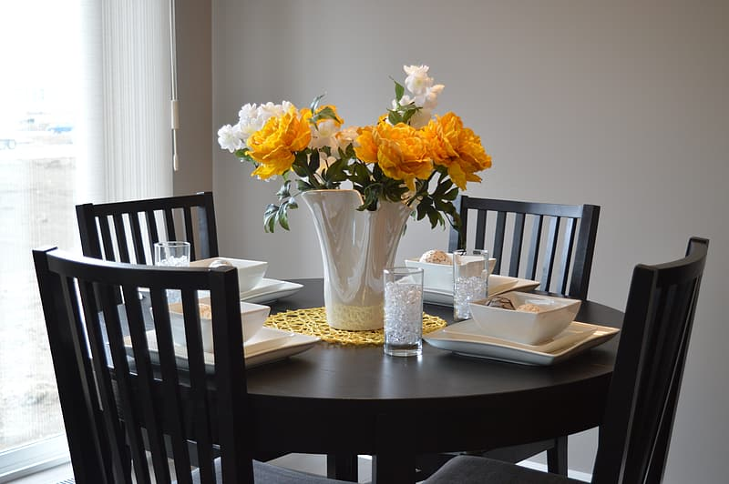 Photo of yellow and white flowers on top of table
