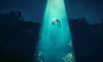 Person floating in blue light