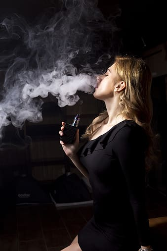 Woman in black shirt smoking