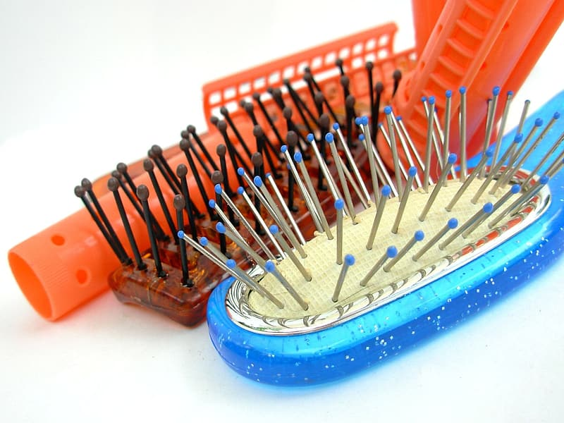 Close-up photo of blue and brown hair brushes