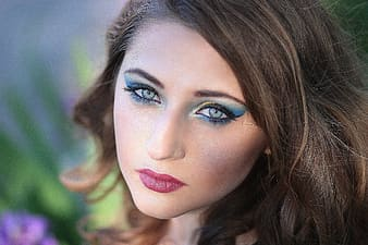 Woman in blue eyeshadow in focus photography