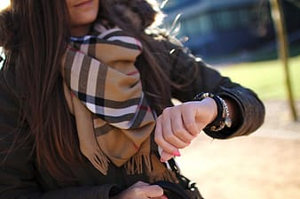 Woman with brown plaid scarf