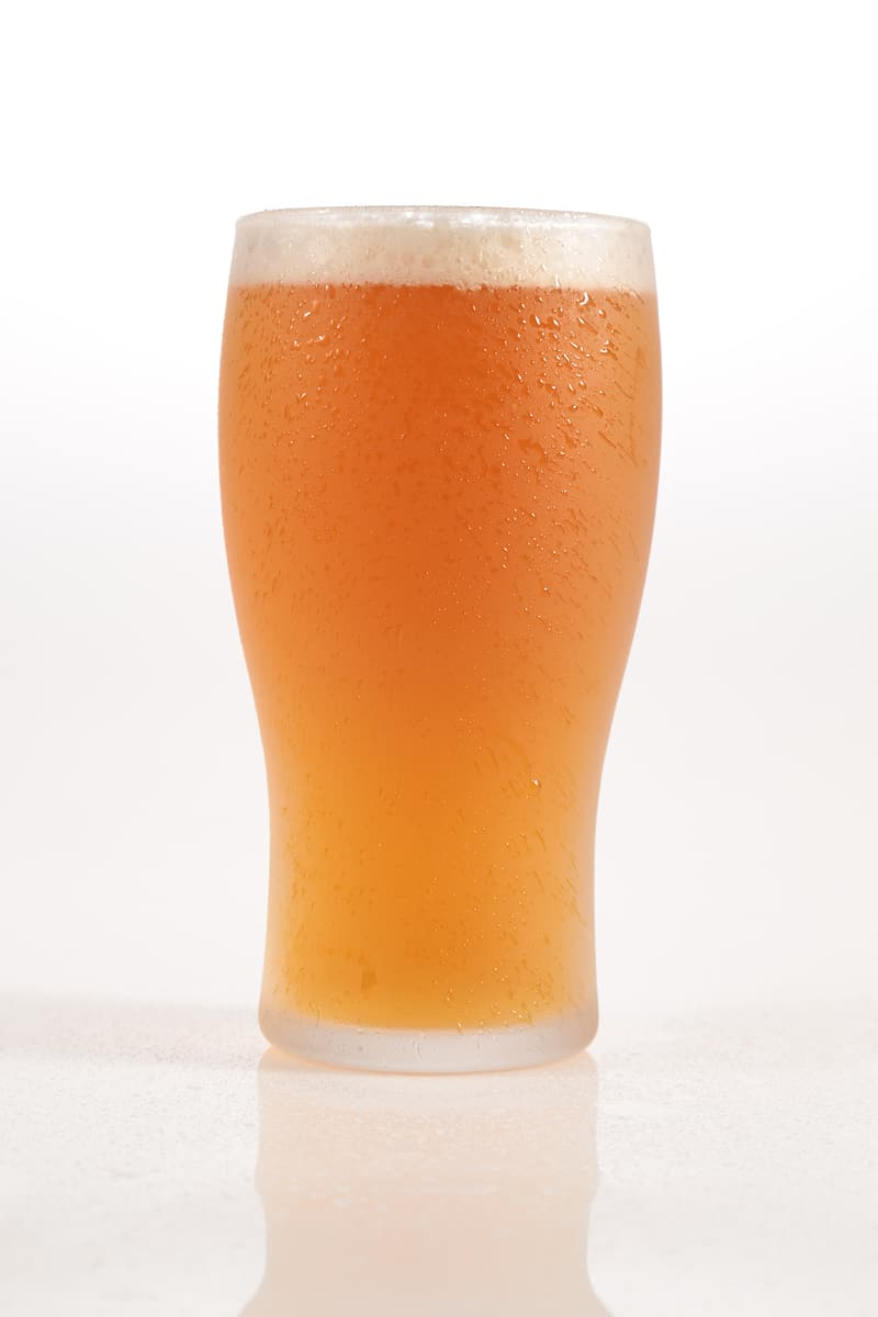 Beer filled clear highball glass
