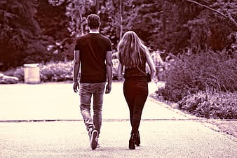 Man and woman walking near road