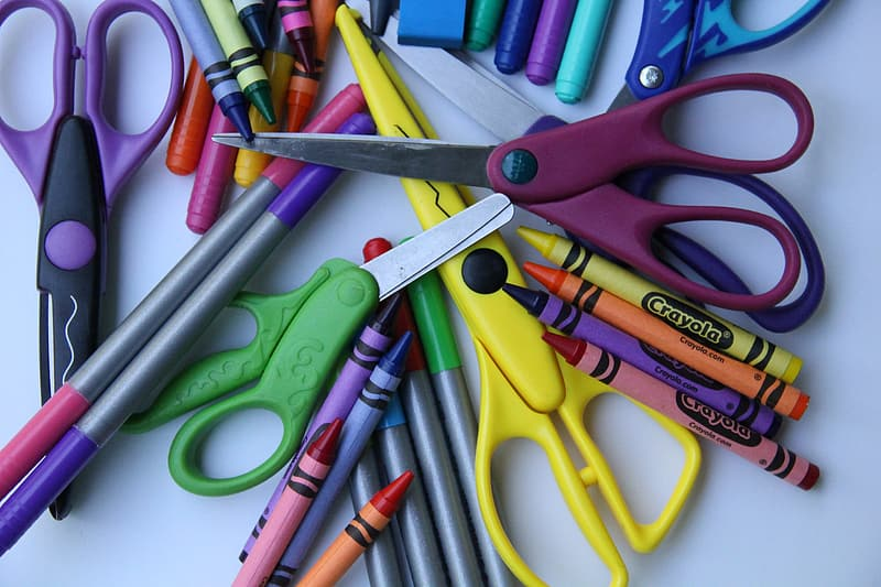 Assorted-color scissors and Crayola crayons