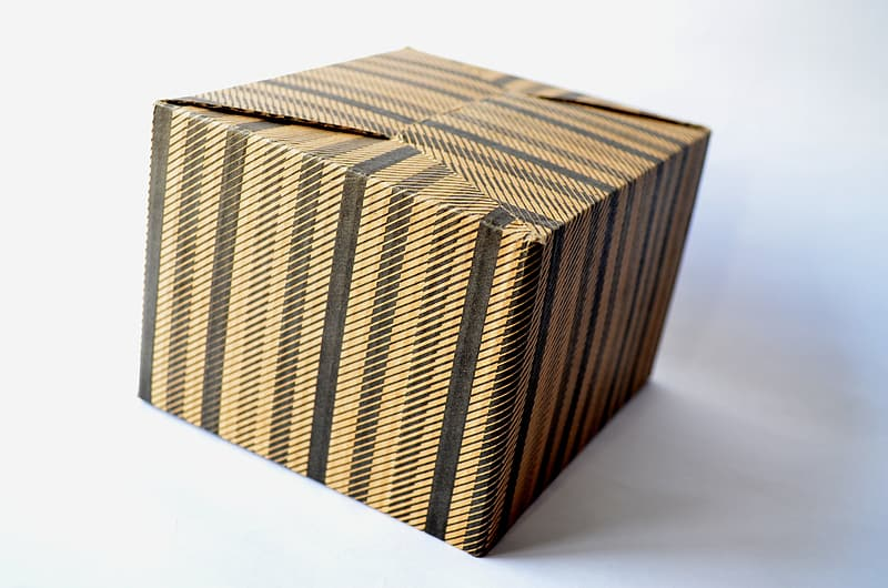 Brown and black labeled box on white surface