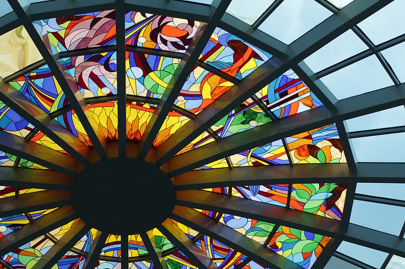 Low-angle photography of stained glass ceiling