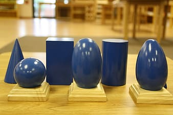 Several blue vases on wooden table