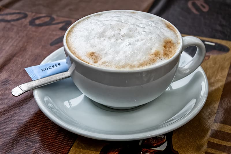 White ceramic cup with saucer
