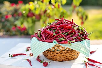 Red chili in brown wicker basket