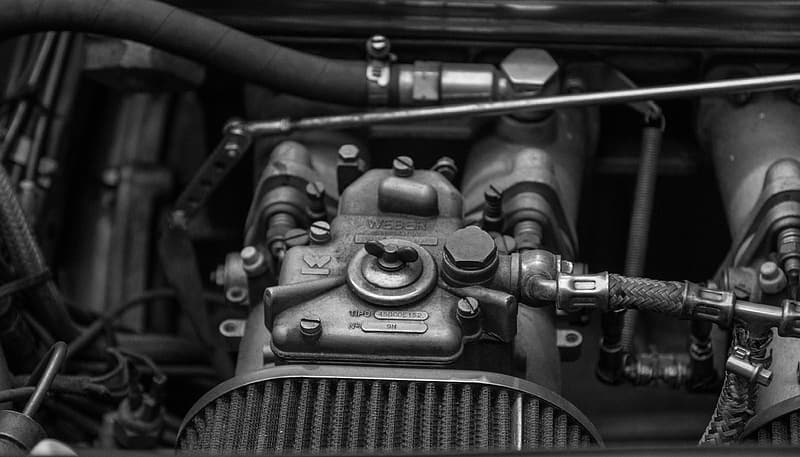 Grayscale photography of vehicle engine