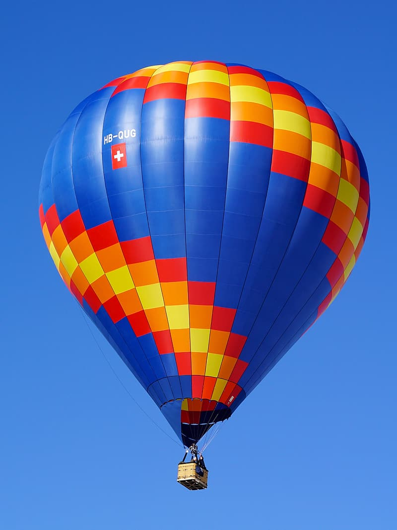 Blue, red, and orange hot air balloon