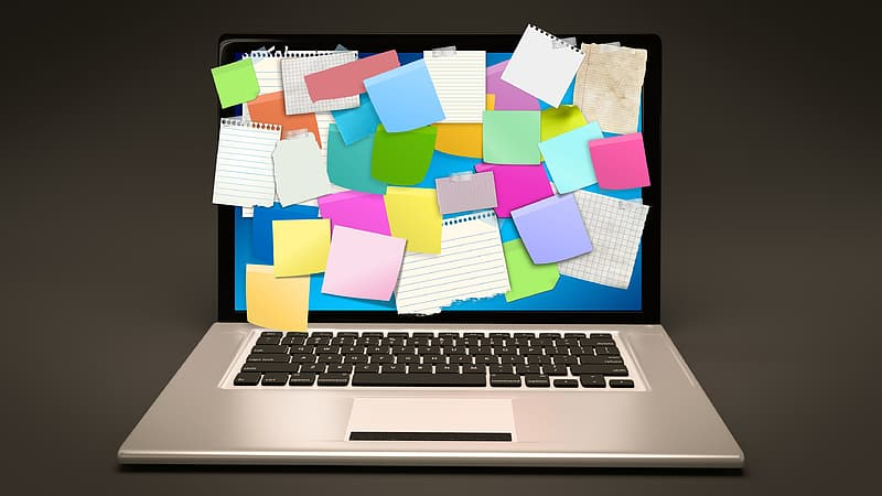 Silver MacBook Pro with sticky notes