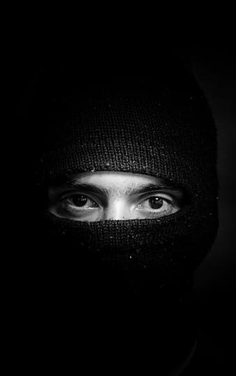 Grayscale photography of man in balaclava