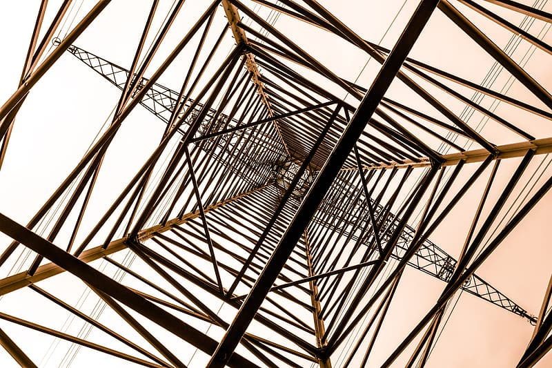 Low angle photography of gray metal tower