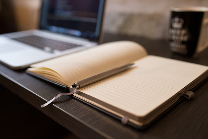 Shallow focus of diary and pen