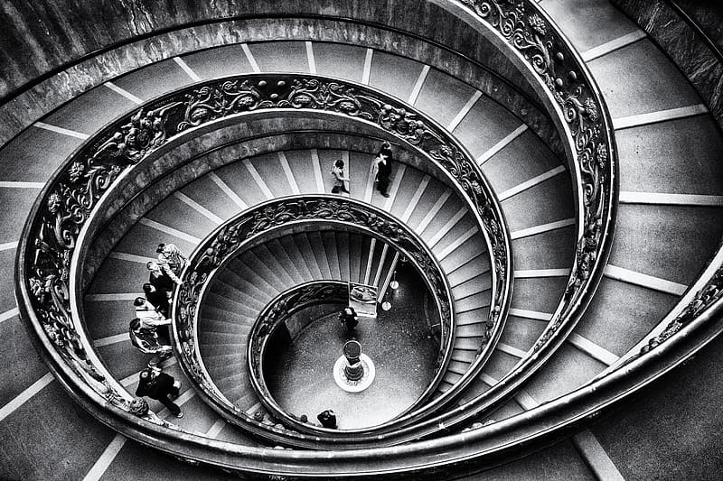 Grayscale photography of spiral staircase