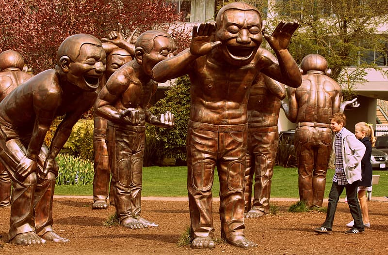 Bronze-colored statues during daytime