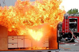 White wooden sideboard on fire at daytime