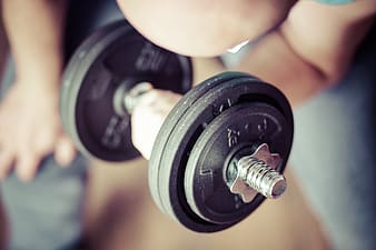 Person lifting dumbbell