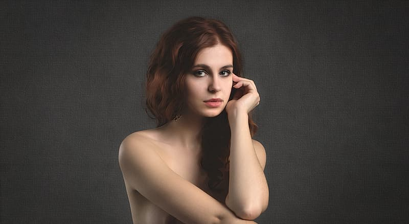 Topless woman with brown hair