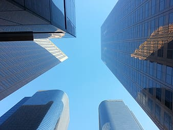 Bottom view of buildings under blue sky