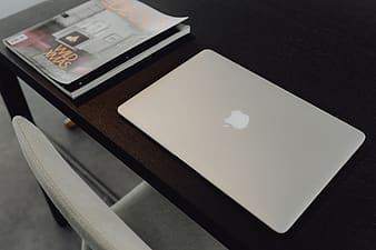 Stylish workspace with MacBook computer on home or studio