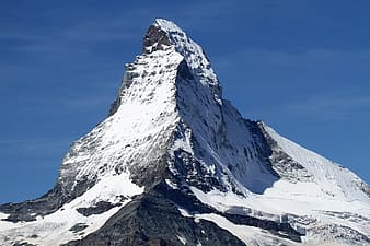 Photograph of mountain coated by snow ice