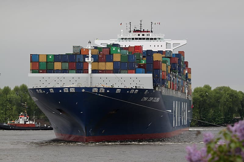 Blue and red cargo ship on sea