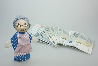 Banknote lot near grandmother doll
