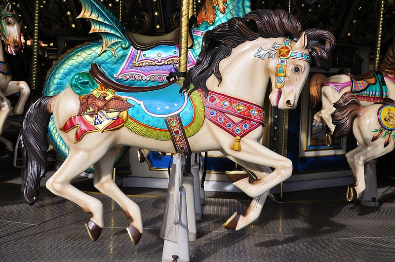White, teal, and red carousel