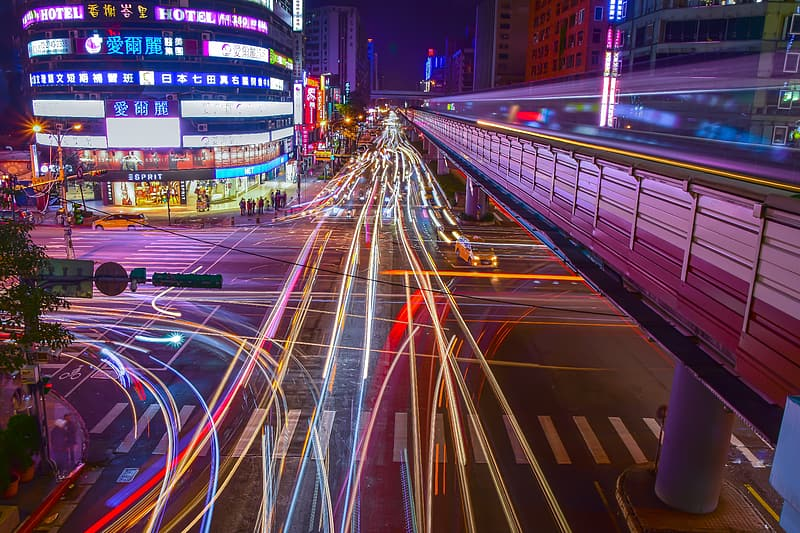 Time lapse photography of road with vehicles and buildings