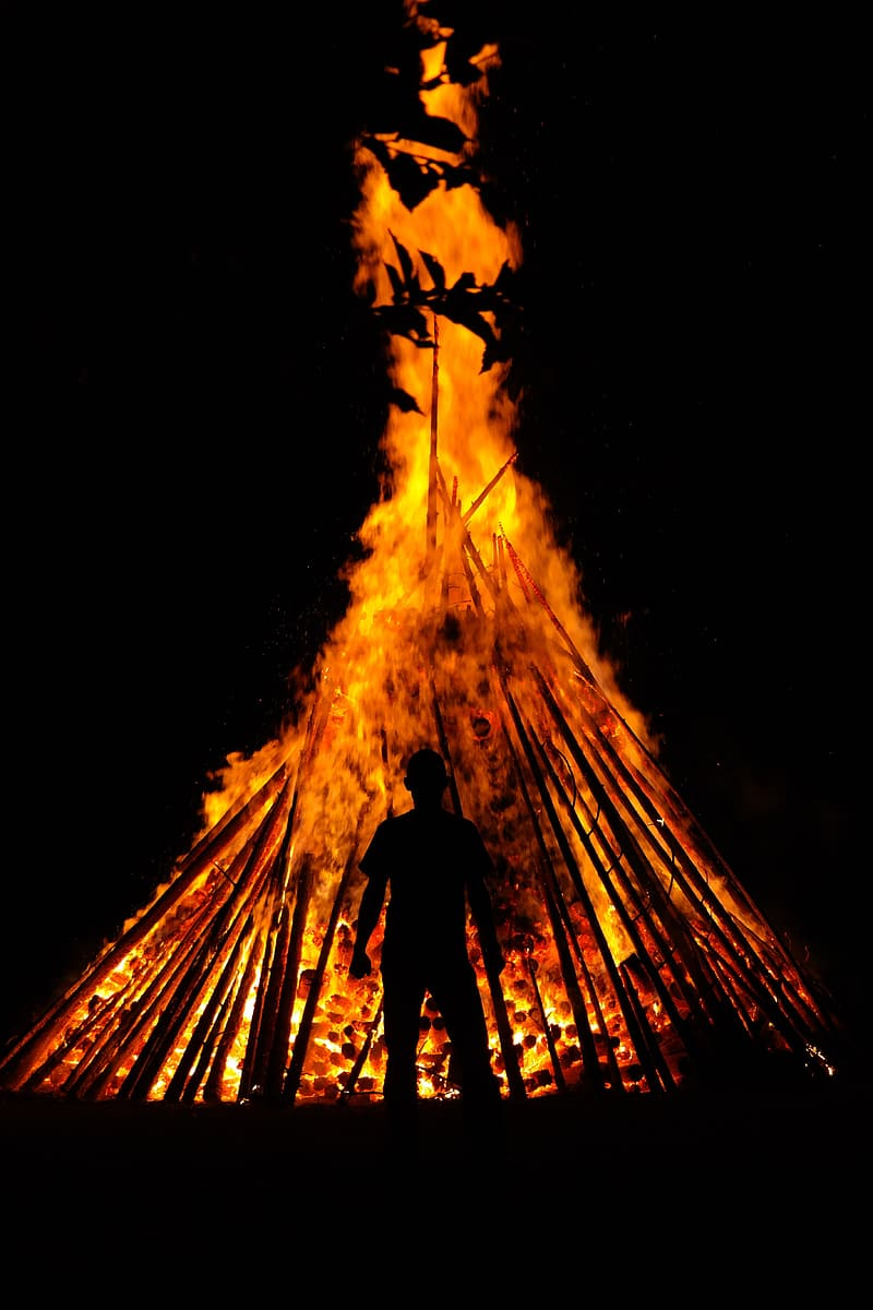 Silhouette photo of man on fire