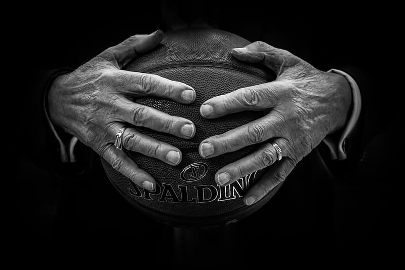 Person holding brown Spalding basketball ball