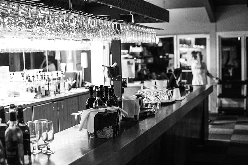 Grayscale photography of bar counter