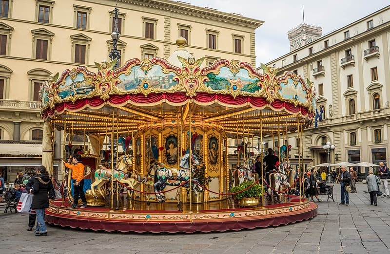 People riding horse carrousel