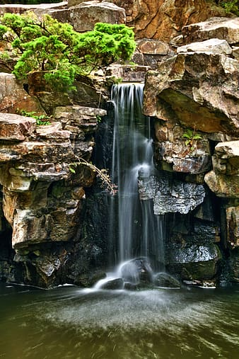 Waterfalls surrounded by brown rocks