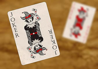 Red, gray, and black Joker playing card