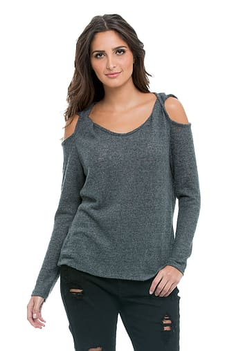Woman in gray cold-shoulder long-sleeved shirt and black jeans