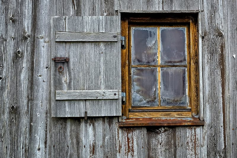 Photo of clear glass window with brown wooden frame