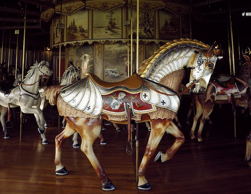 Brown and white horses in carousel