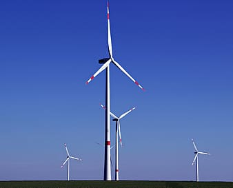 White wind turbine under blue sky during daytime