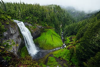 Water falls surrounded with mountain range