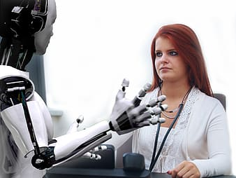 Woman in white cardigan in front of robot