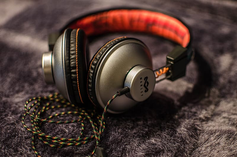 Selective focus photograph of gray and black corded headphones