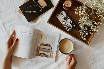 Woman read book and drink coffee