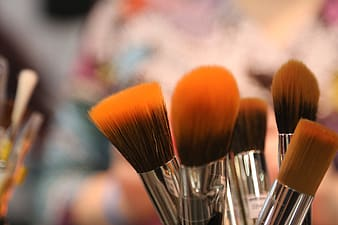 Closed-up photo of brown and gray makeup brushes