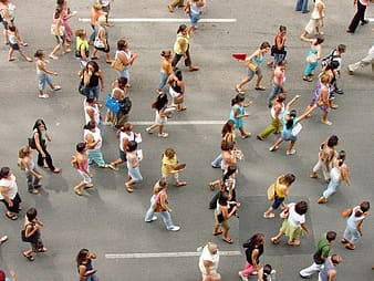 People walking in the road during daytime