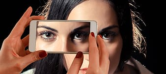 Woman taking picture of her eyes
