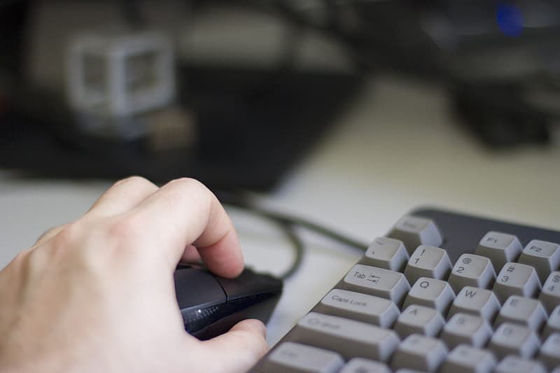 Person using optical mouse
